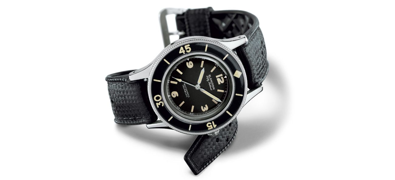 Sixty-five years of setting the bar for dive watches.  It helps that the boss is for real. Back in the 1950s, Blancpain had an avid diving fan in then-CEO Jean-Jacques Fietcher. While water-resistant watches were already a norm by then, with the likes of the Rolex Oyster, Omega Marine and Hamilton Sea Bees constantly improving on the said feature – and particularly throughout World War II where conditions demanded improved functionality – proper dive watches were still uncommon. Nevertheless, Fietcher instructed the company to develop a tool-watch that he himself could use on his leisure dives.  Holidays are truly the best. Never mind the military muscle that one commonly associates with the Fifty Fathoms collection today – the very first prototype was tested by Fietcher on the sunny coastal waters off the south of France. It was the success of the test, to which the watch survived a depth of 91m, the equivalent of 50 fathoms (the metric commonly used by divers), that the timepiece was christened Fifty Fathoms.  Just so you know, the Fifty Fathoms wrote the blueprint. As the concept of civilian dive watches took shape, so did their attributes. Those who need an official checklist of features can look up the ISO 6425 international performance standards, which was introduced in 1996. They include, amongst others, a unidirectional bezel (or a similar digital device) to measure the amount of time left in your oxygen tank, thermal shock resistance, resistance to salt water, underwater functionality, and at least 200m water resistance for deep sea diving. And guess what – the key must-haves listed in the ISO 6425 pertaining to safety, reliability, sturdiness, readability and anti-magnetism were already established by Blancpain in 1953.  And the watch isn't just for show, either. The same year that Fietcher ok-ed the first Fifty Fathoms, the French Navy serendipitously asked Blancpain to produce dive watches to equip its elite combat diver unit, which the brand duly obliged. And in the professional-civilian sphere, the Fifty Fathoms has been donned by the likes of legendary divers both past and present, such as Jacques-Yves Cousteau, Gouffre Berger, and Laurent Ballesta.  The Fifty Fathoms Bathyscaphe has dominated in recent years. For the collection's 60th anniversary in 2013, Blancpain introduced the Fifty Fathoms Bathyscaphe, a vintage-style model for both men and ladies. Improved with modern innovations that span automatic movements with silicon balance springs, to scratch-resistant bezels made from a proprietary alloy called 'Liquidmetal', the Fifty Fathoms Bathyscaphe, we imagine, must have been a phenomenal success. Why? Because the brand had largely been riffing on the Fifty Fathoms Bathyscaphe for the past few years, offering versions that range from limited edition flyback chronographs that support marine preservation (Fifty Fathoms Bathyscaphe Ocean Commitment Flyback Chronograph, 2015), to models clad in ceramic (2016).   But for variety, check out the 2018 models. Spanning cool retro styles to minor-complications, this year's Fifty Fathoms offerings, we think, get the mix just right. The Bathyscaphe Day Date 70s, limited to 500 pieces, is a tasty one, its throwback game strong with a unique gradient dial and bold indexes. For more sophisticated options, there are the Bathyscaphe Annual Calendar and Fifty Fathoms Grande Date, both powered by calendar complications that are Blancpain's strong suit. And so that you remember, the watches' swanky styles do not in any way inhibit their tool-watch performance. Go ahead and put them to the test if you want.