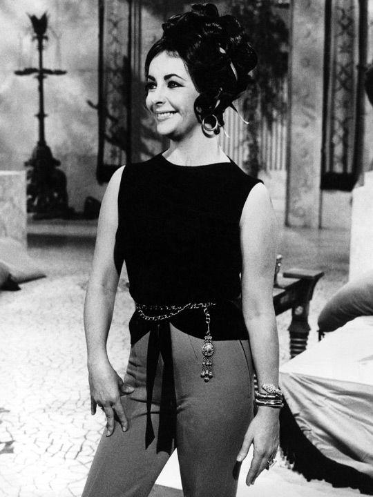American actress Elizabeth Taylor on the set of 'Cleopatra' in 1961 wearing a 'serpenti snake' bracelet-watch